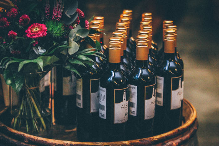 Wine bottles and a floral arrangement set up for a function
