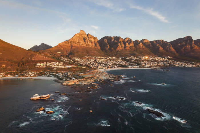 Aerial photo of the sea and mountains by Camps Bay